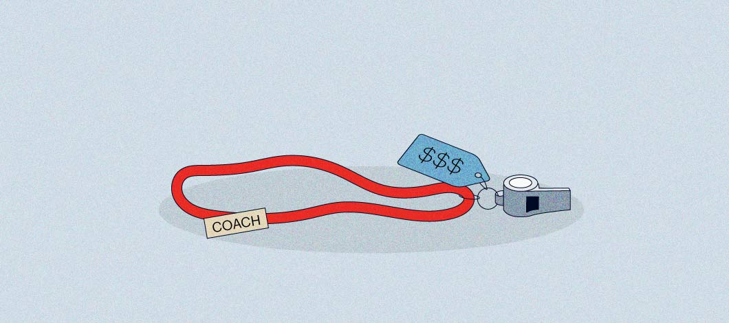 """Red string for a necklace with a name tag that says """"Coach."""" There is also a silver whistle on the string with a price tag with 3 dollar signs on it."""