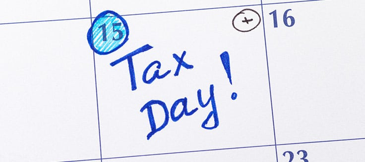 "The 15th day is circled on a calendar, with the words ""Tax Day!"" written in marker."
