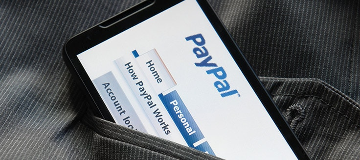 The PayPal mobile site is on a smartphone screen. PayPay is among the payment service providers your business can use to accept credit card payments.