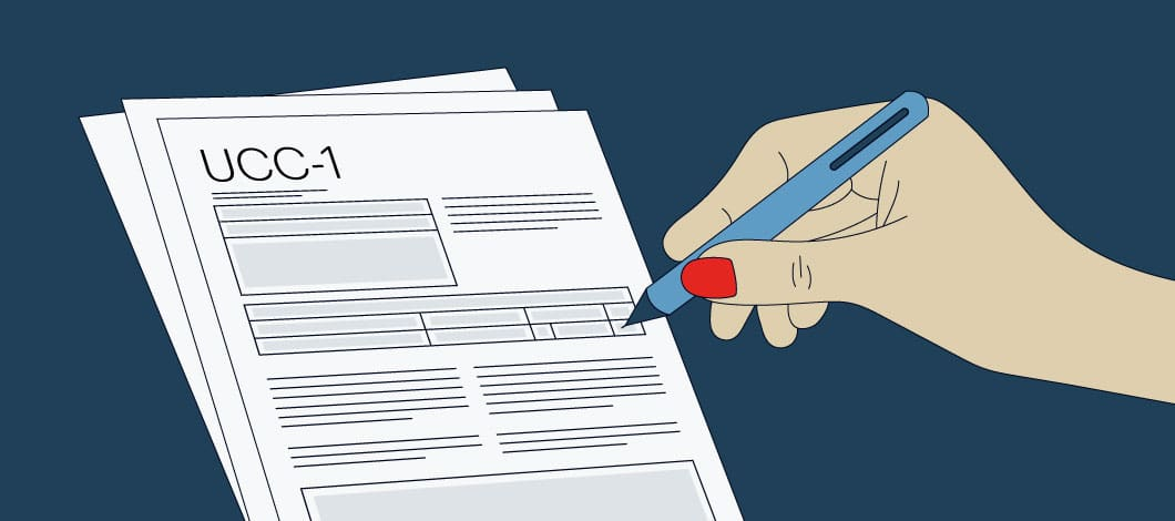 Person filling out UCC-1 form