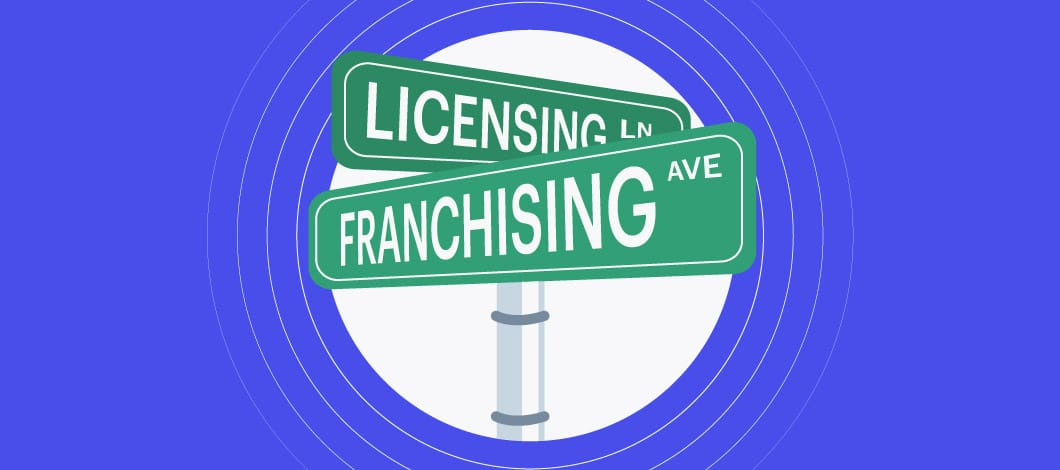 """Two street signs on a pole: One reads """"Franchising"""" and the other reads """"Licensing."""""""
