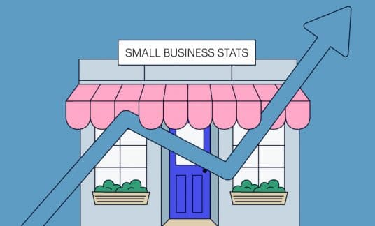 A small business shop stands as the backdrop for a bar chart line showing an upward trend.