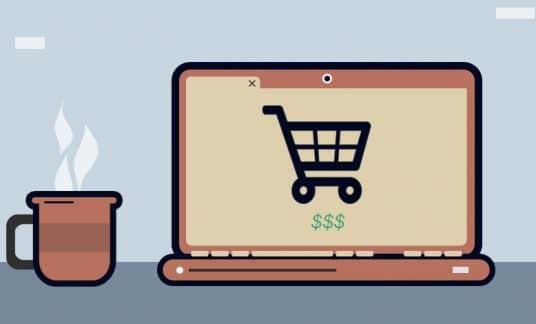 A laptop screen displays an online shopping cart.