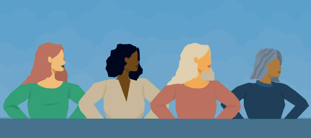 Successful female entrepreneurs: Four women of different colors, backgrounds and ages stand triumphantly side by side.