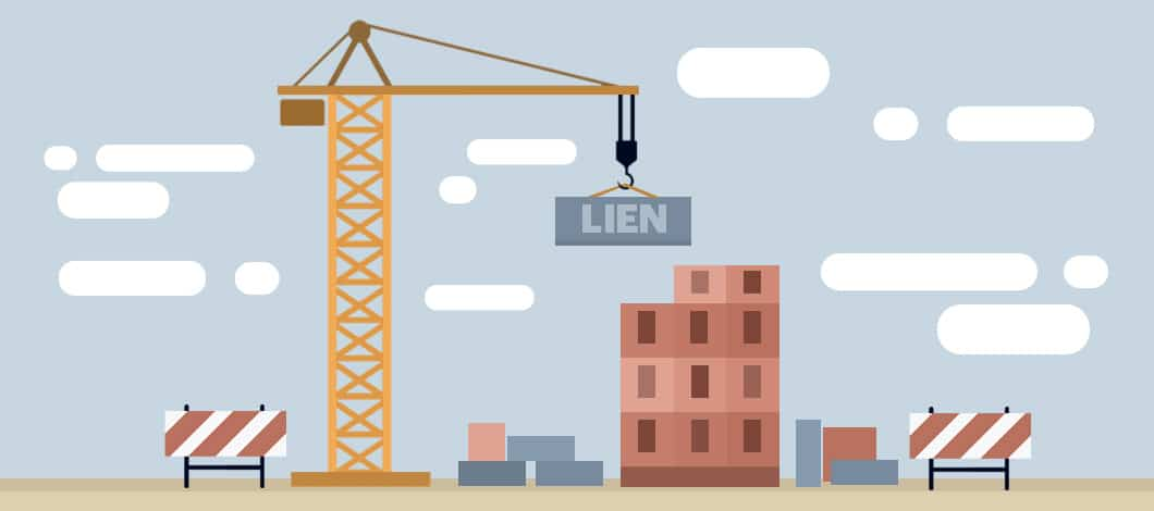 """A crane lowers a cinder block labeled """"Lien"""" to a building under construction."""