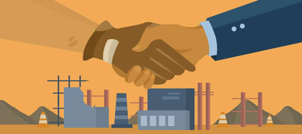 Two hands, one from a construction contractor wearing work gloves, the other from a business professional, shake. A factory is under construction in the background.