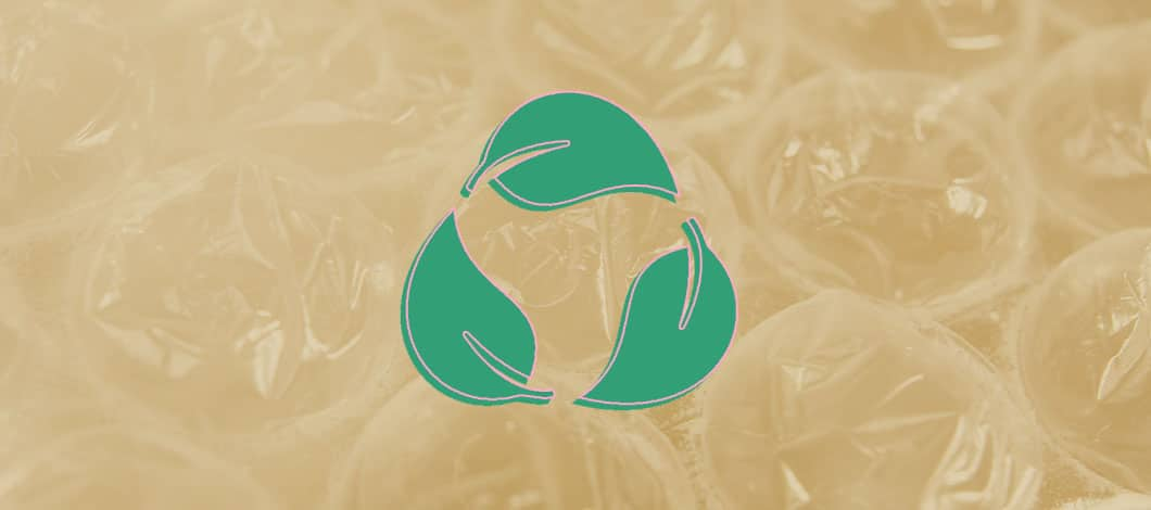 This is a close-up of bubble wrap with the biodegradable symbol in green.