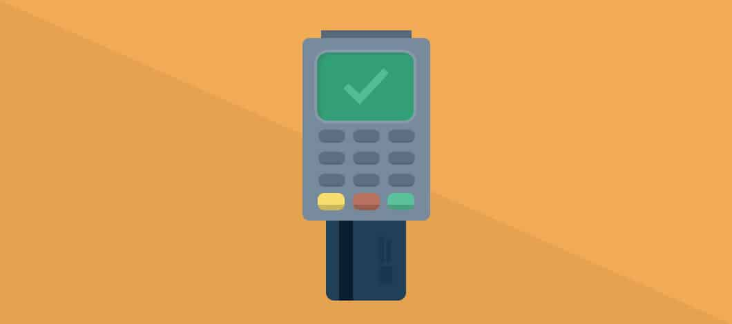 A credit card has been inserted into a chip reader to process a payment.