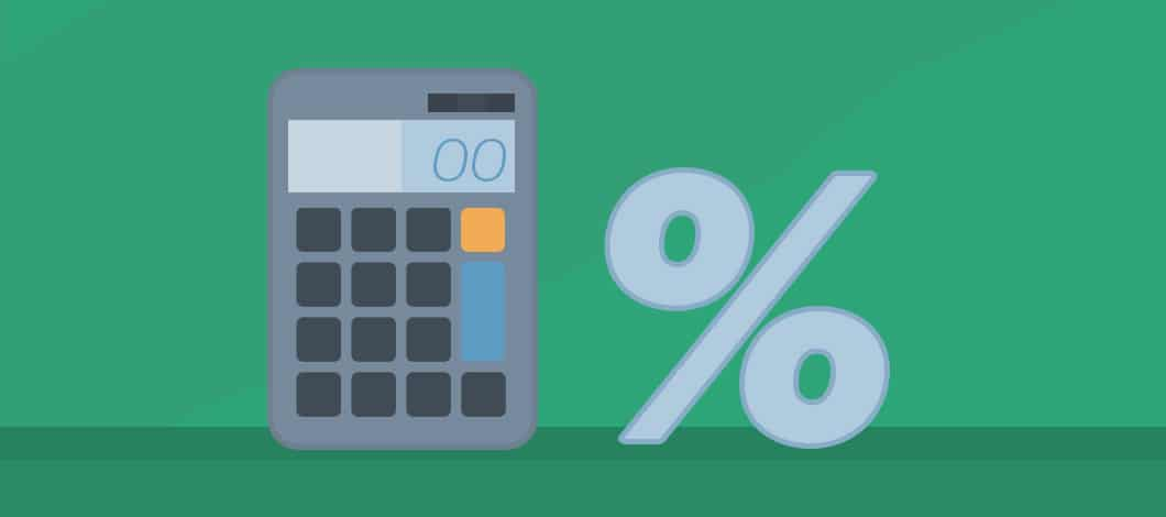 A calculator stands next to a giant percentage sign.
