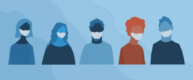 We see the masked heads and torsos of 5 co-workers distanced, but standing side by side. Four of them are blue in color. One person, the second from the right, is red.