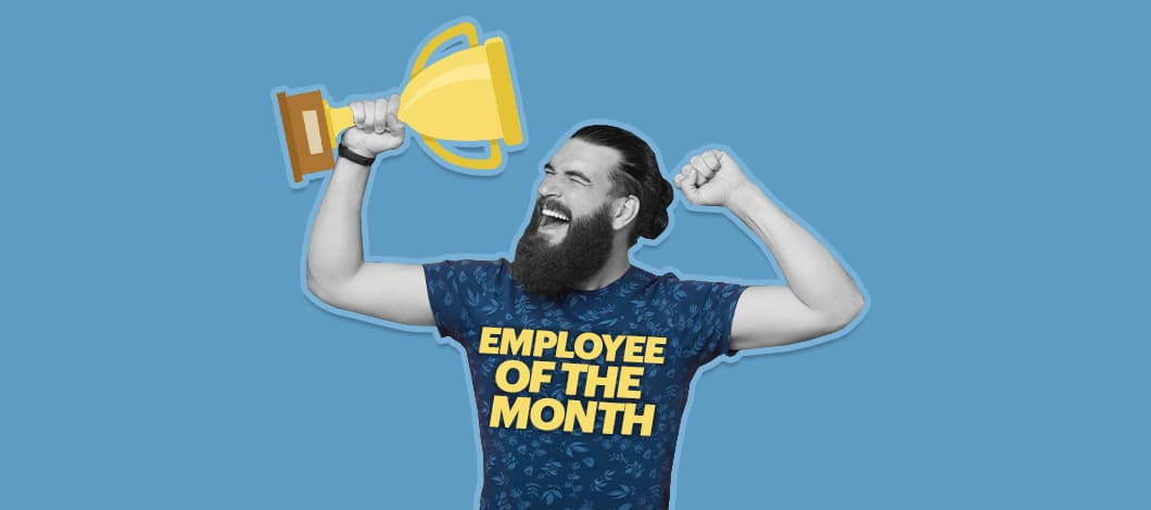 """A happy worker wearing an """"Employee of the Month"""" shirt hoists up a trophy."""